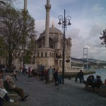 Ortakoy Mosque with people enjoying the view.